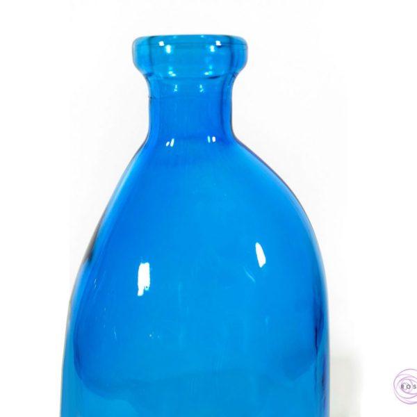 Butelka dali niebieska pod wieczne róże